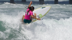 Shelby Detmers surfing