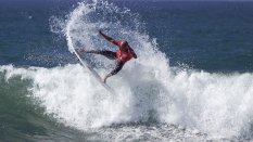 Kelly Slater surfer getting air surfing Trestles