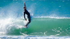 Longboarder-hanging-five-in-the-curl