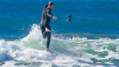 Surfer Hanging Five Other Foot Off of Board