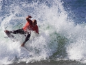 Kelly Slater fins out surfing