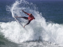 Kelly Slater surfer getting air surfing Trestles
