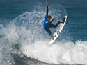 Miguel Pupo getting air surfing Trestles
