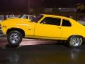 yellow chevy nova wheelie