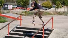 Skateboarder Jump to Backside Grind