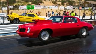 drag-racing-camaro-versus-ford-mustang