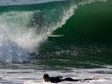 Surfer getting tubed on a wave