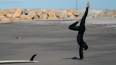 surfer-doing-handstands