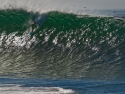 surfingbigwavesatthewedgenewportbeach